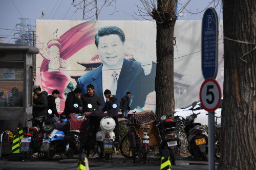 2018年3月19日,北京街头的一处褪色的习近平标语牌。
